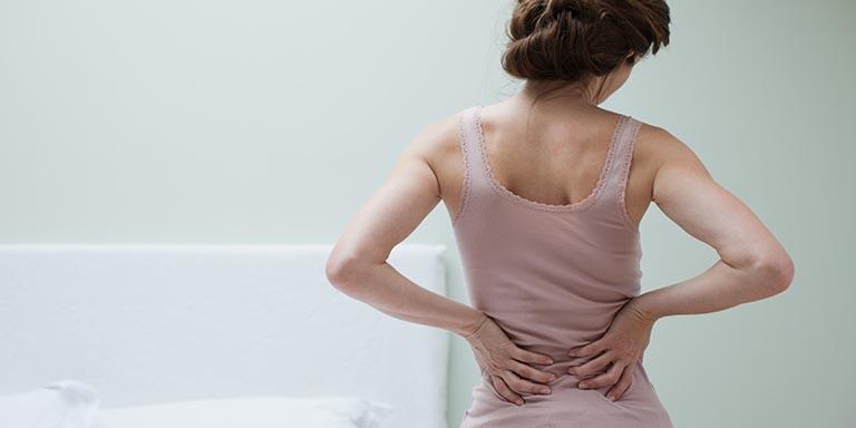 Đau lưng khi mới thụ thai là do đâu?