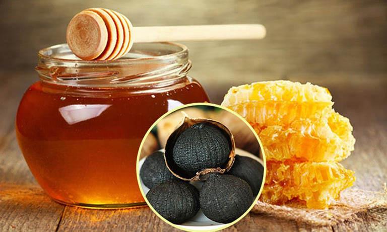 Công dụng của tỏi đen ngâm mật ong chữa đau dạ dày